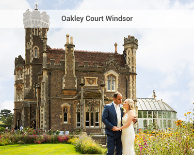 Wedding couple stand with the gothic Windsor wedding venue Oakley Court in the background
