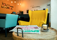 Professional photograph of the foyer of the Jelly Lounge in Windsor, table set with Sunday papers and coffee