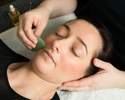Use of GuaSha during Zone Face Lift facial reflexology treatment