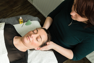 Michaela Spear of Windsor's Spear Reflexology givng a facial relexology and Zone Face Lift treatment