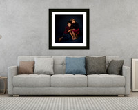 3D rendering of interior with sofa, coffee table and lamp, with framed photo of a brother and sister above the sofa